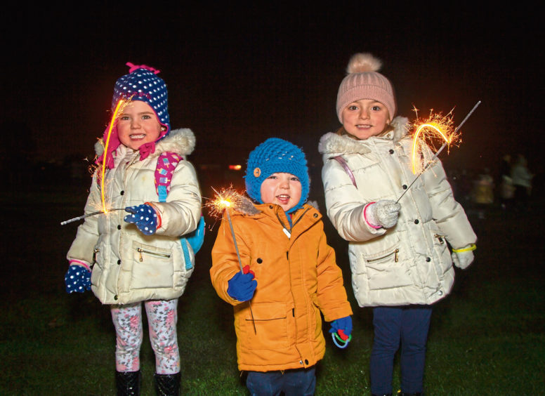 Ava Burgess, 4, with her brother Kai, 2, and sister Mia, 6, at Lochee Park,