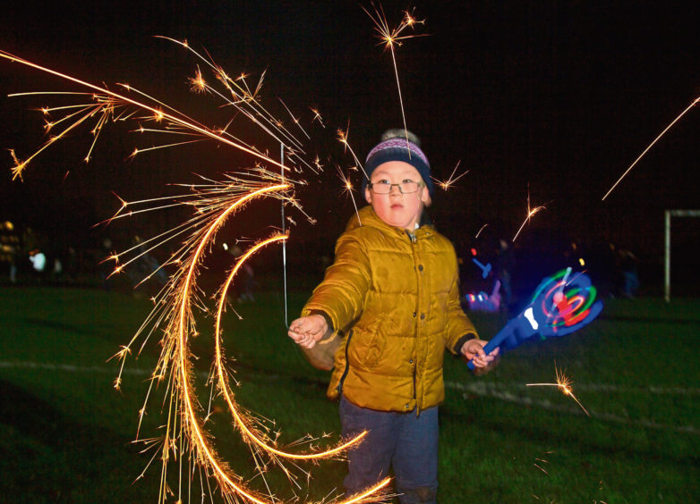 Ray Sun, 5, twirling his sparkler at Lochee Park.