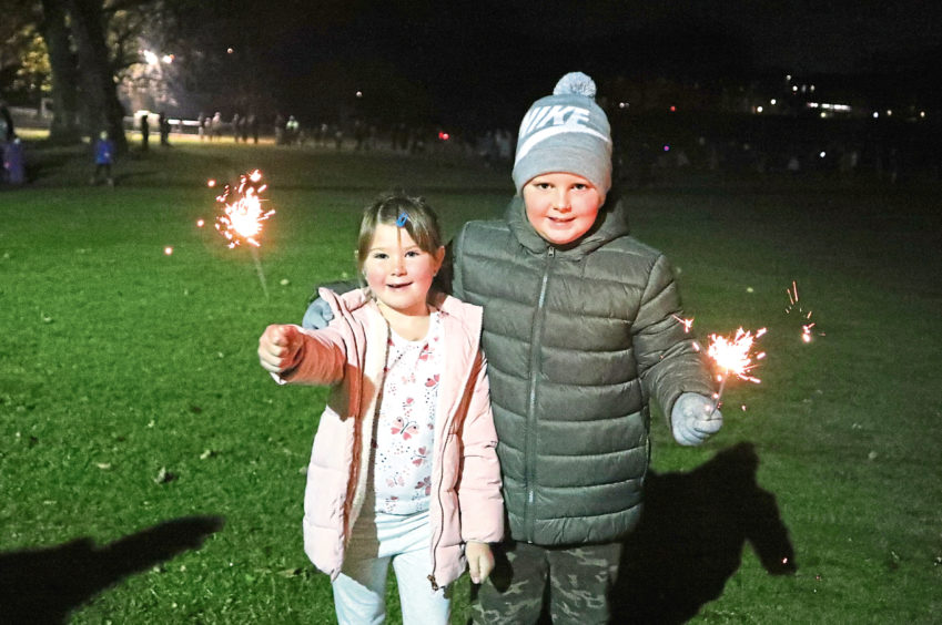 Jess, 6, and Scott, 8, Petrie, from Broughty Ferry, at the Baxter Park display.