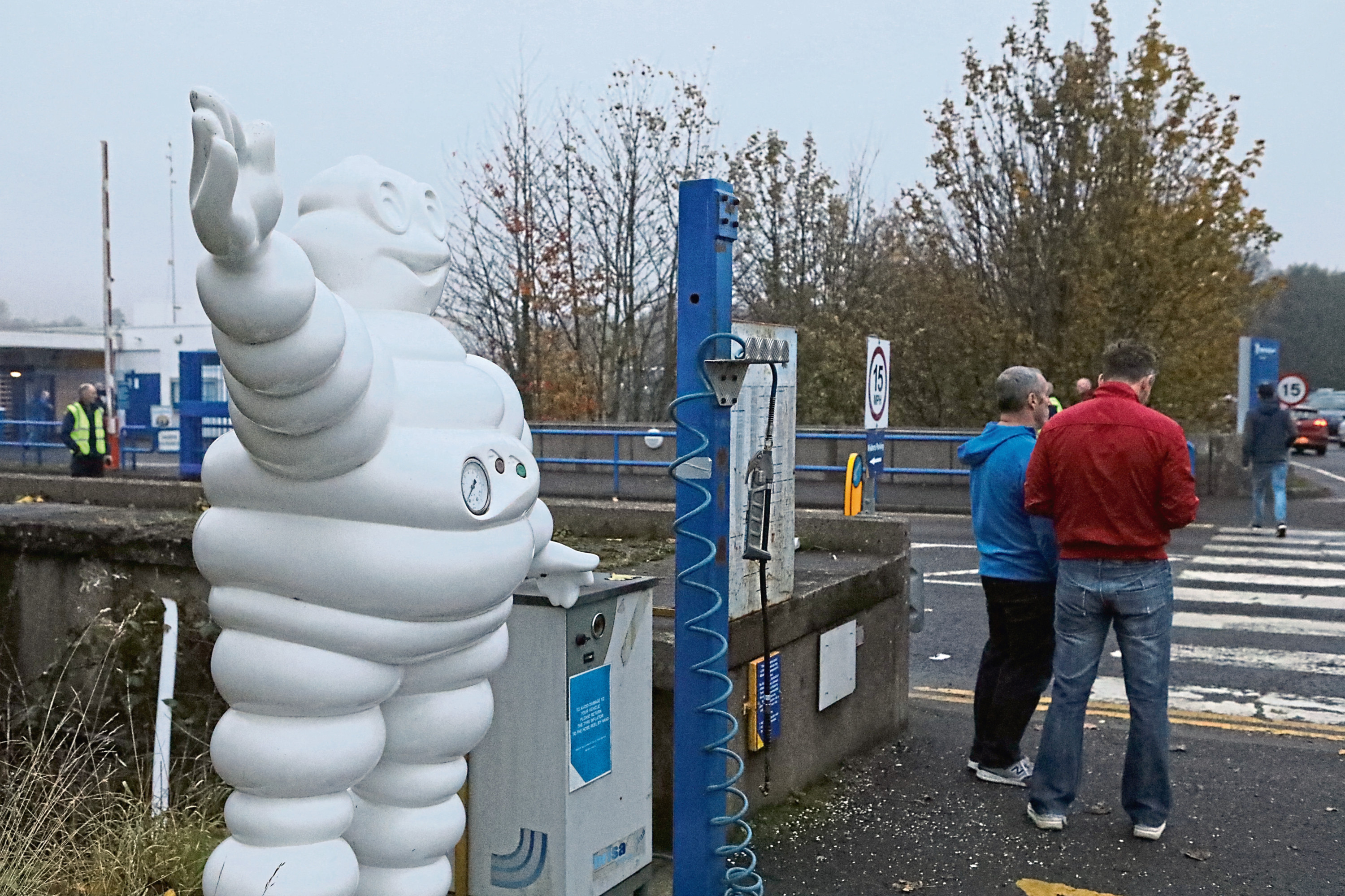 Workers outside the Michelin factory on Tuesday.