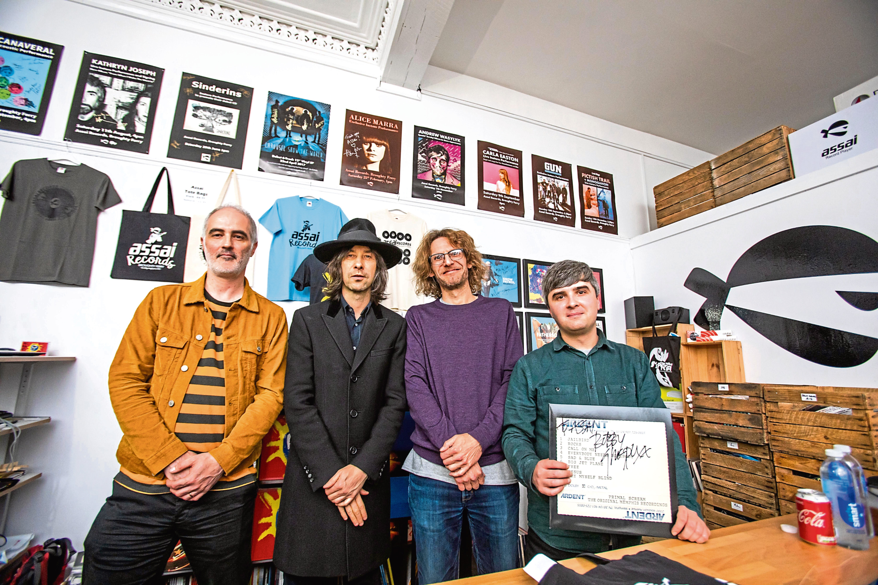Picture shows, from left, Graham Ogston, interviewer and guitar/bass player with Spare Snare, Bobby Gillespie, Andy McLaren of Assai and shop manager Matthew Marra.
