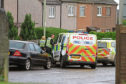 Multiple police officers and officers in Grange Road, Monifieth