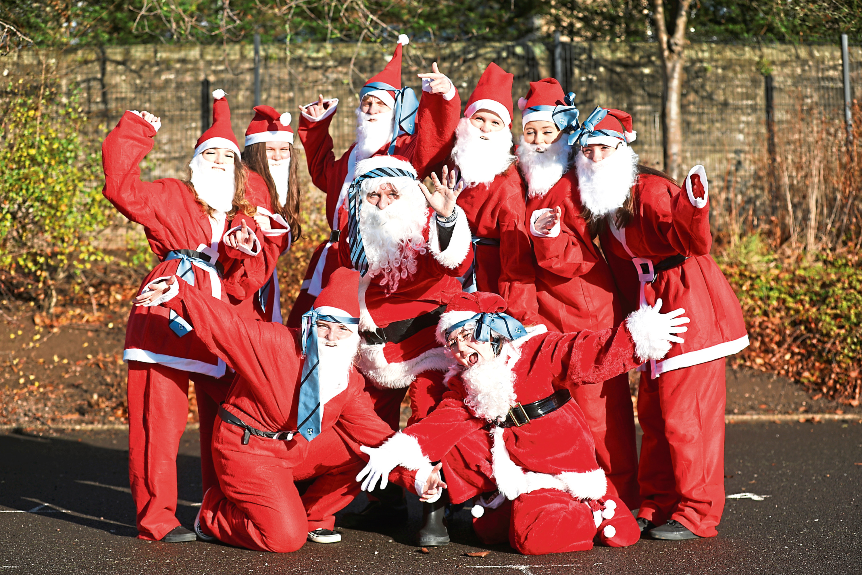 S5 and S6 pupils who will be taking part in the Santa Dash with events and promotions officer Garry Smith (centre)