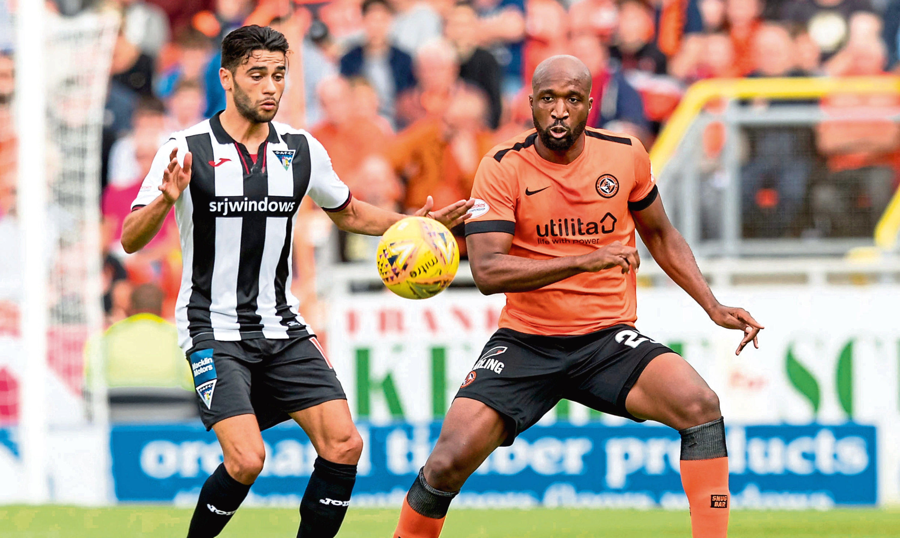 Dundee United's William Edjenguele (right) in action with Dunfermline's Faissal El Bakhtaoui