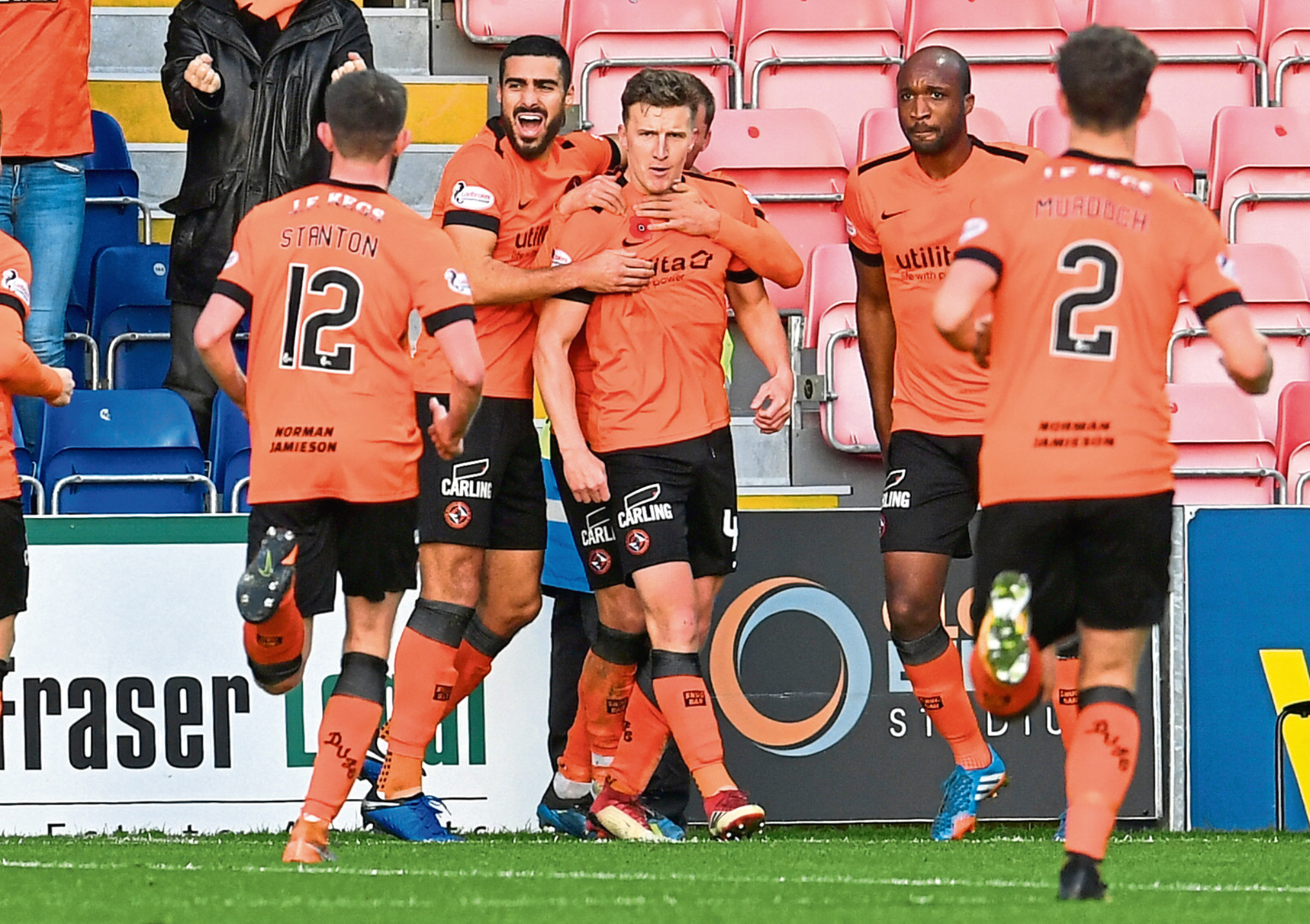 Dundee United players celebrate Paul Watson's (centre) winner against Ross County in Dingwall.