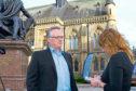 Reporter Lindsey Hamilton interviews Michelin boss John Reid