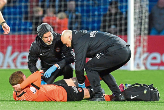 Fraser Fyvie receives treatment on the pitch during the weekend win at Ross County. The midfielder had to go off with a hamstring problem.