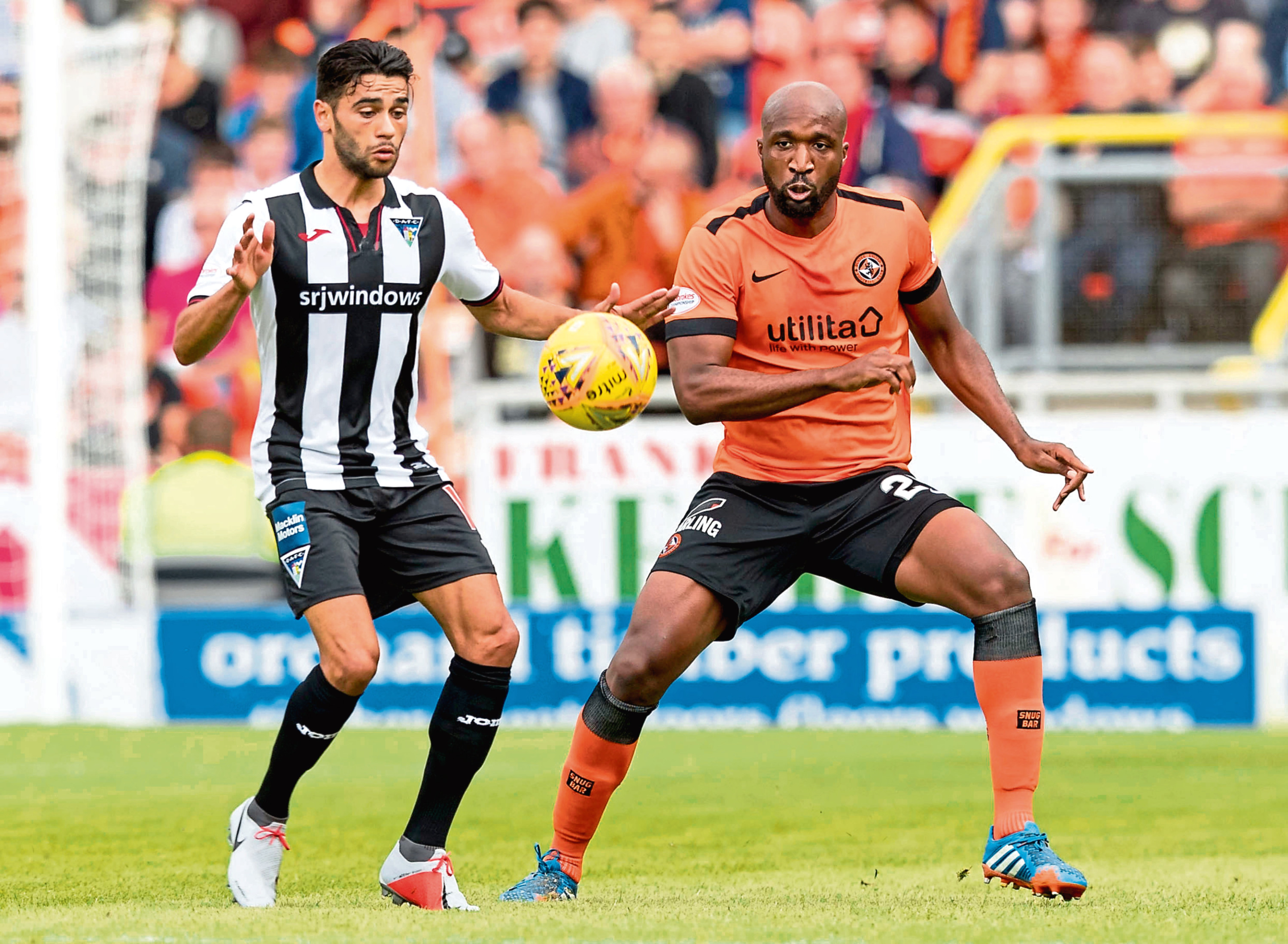 Dundee United boss Robbie Neilson has been delighted with the form of William Edjenguele (right) after the defender was restored to the side