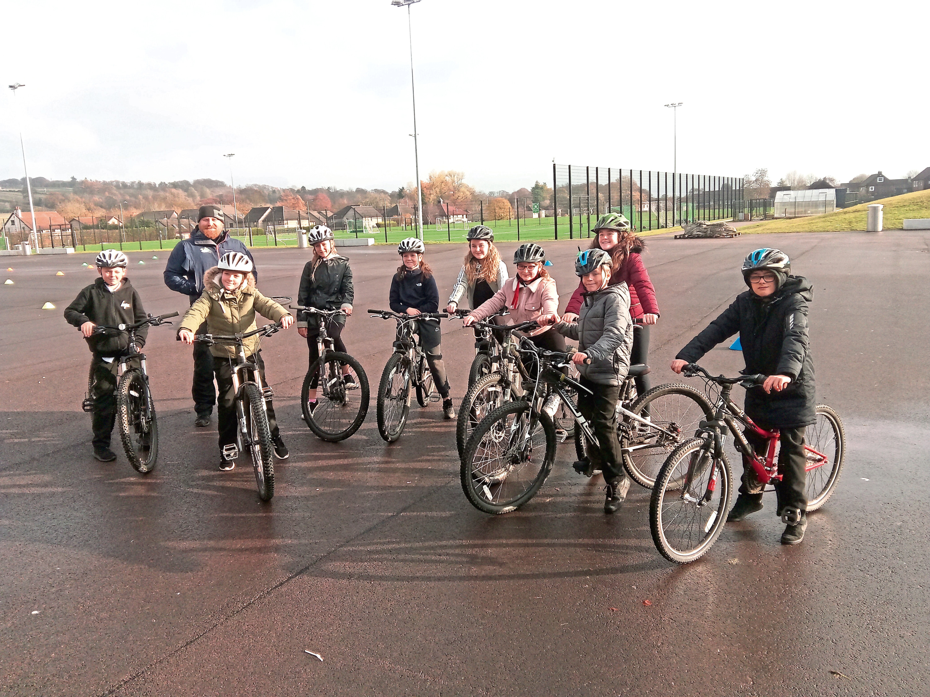 Some of the pupils on their bikes with trainer Grant Pettigrew