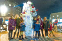 Picture shows a group of children being enchanted by one of the magical characters who were roaming City Square to the delight of the revellers