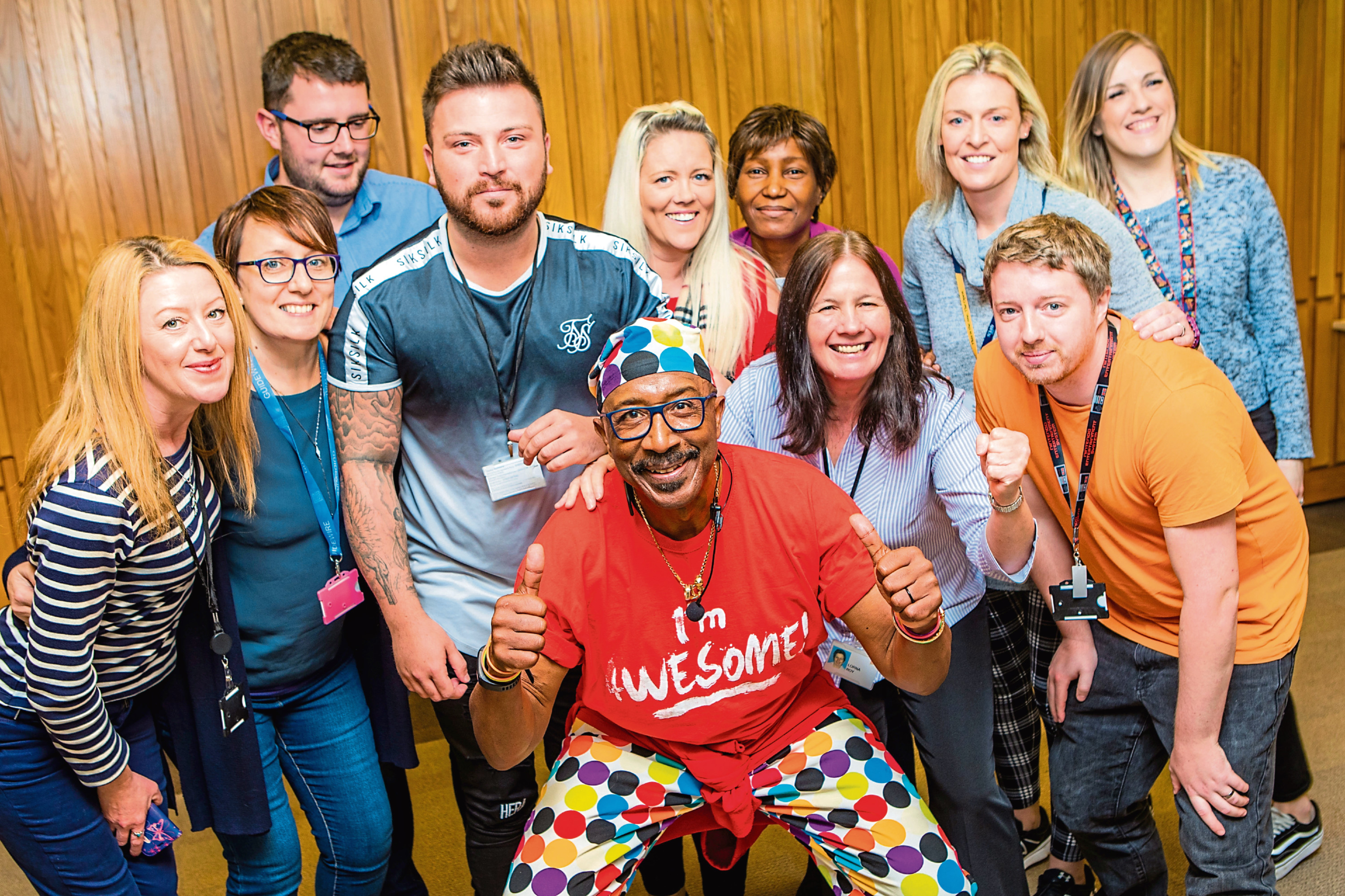 Picture shows staff posing with Mr Motivator at Aviva on Pitheavlis Terrace.