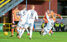 Nicky Clark equalises and opens the scoring for Dundee United in what was a hard-fought 4-2 victory against Alloa Athletic at Tannadice on Tuesday night.