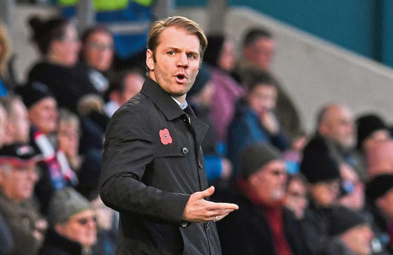 Dundee United manager Robbie Neilson has been impressed with his squad.
