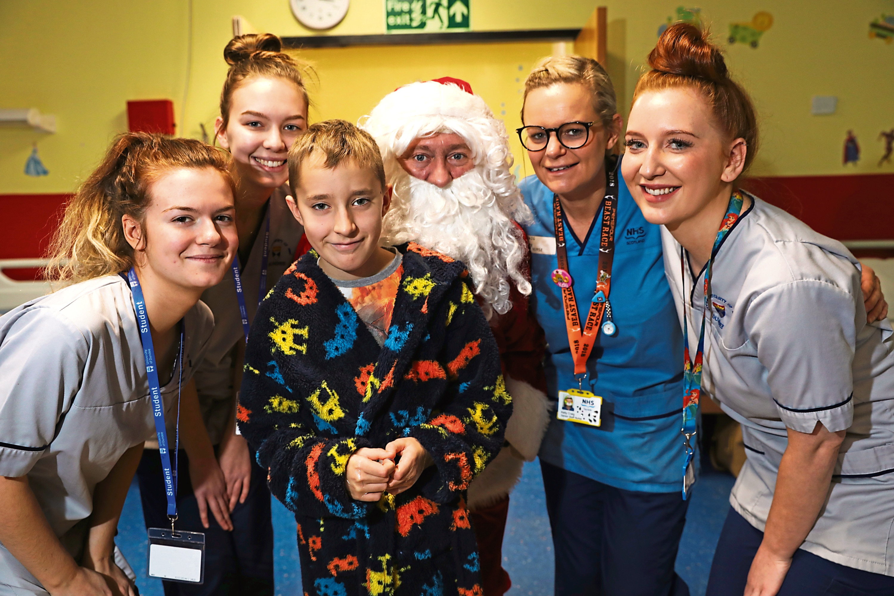 Garry Smith, from Leisure and Culture Dundee, dressed up as Santa with nurses Katie Patton, Gemma McFarlane, Kelly Craig and Amy Corrigan and patient Finlay McKay
