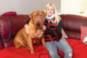 Leslie with her own pooch Avi, a Dogue de Bordeaux, or French mastiff