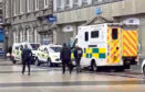 Police outside the flat in Dundee city centre