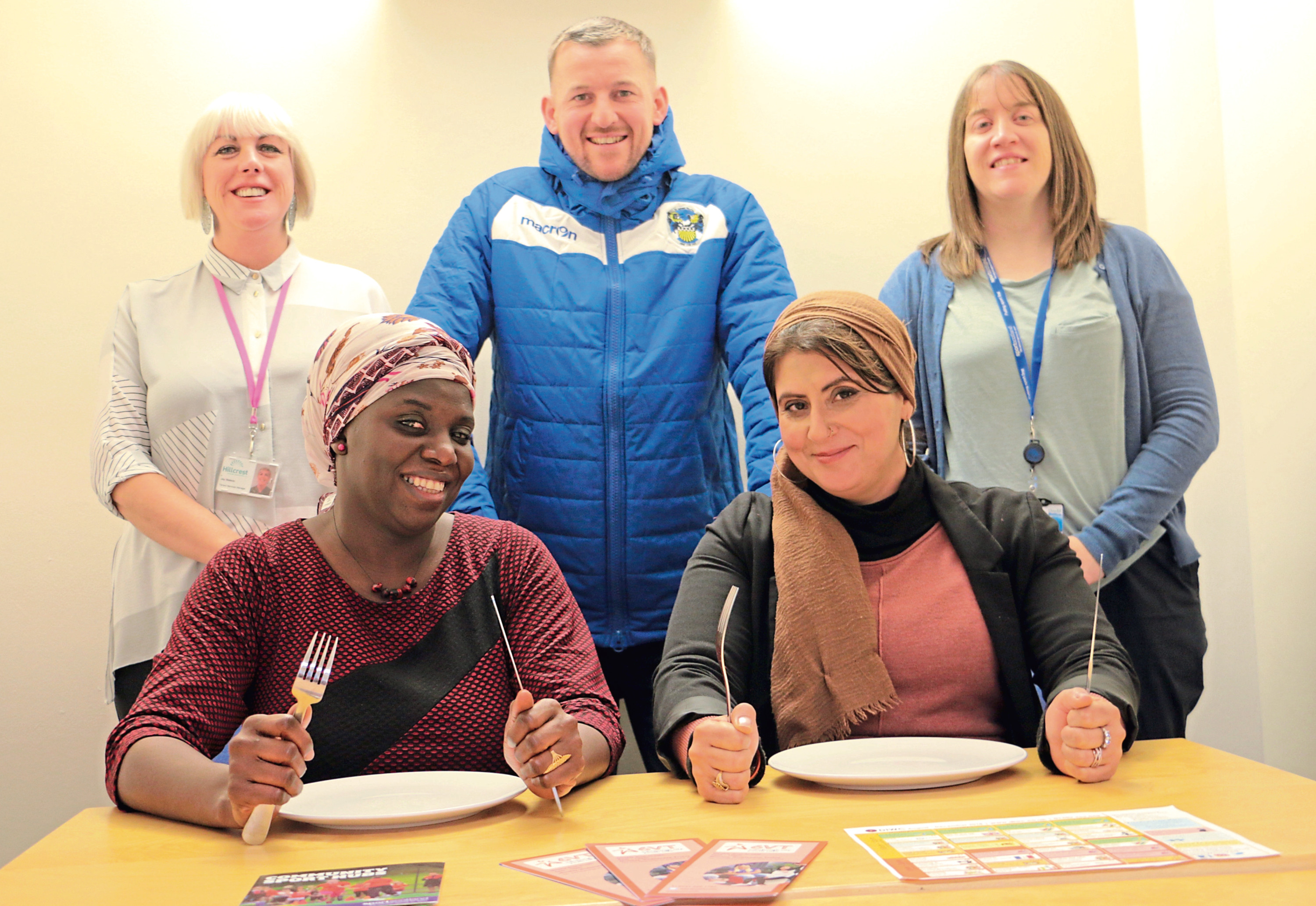 Picture shows, back row, from left: Hillcrest tenancy services manager Joy Watson, Fairfield project officer John Cairney and sports hub officer Alison Mackenzie. Front: DIWC project workers Diaré Drammeh and Fatima Ramzan.