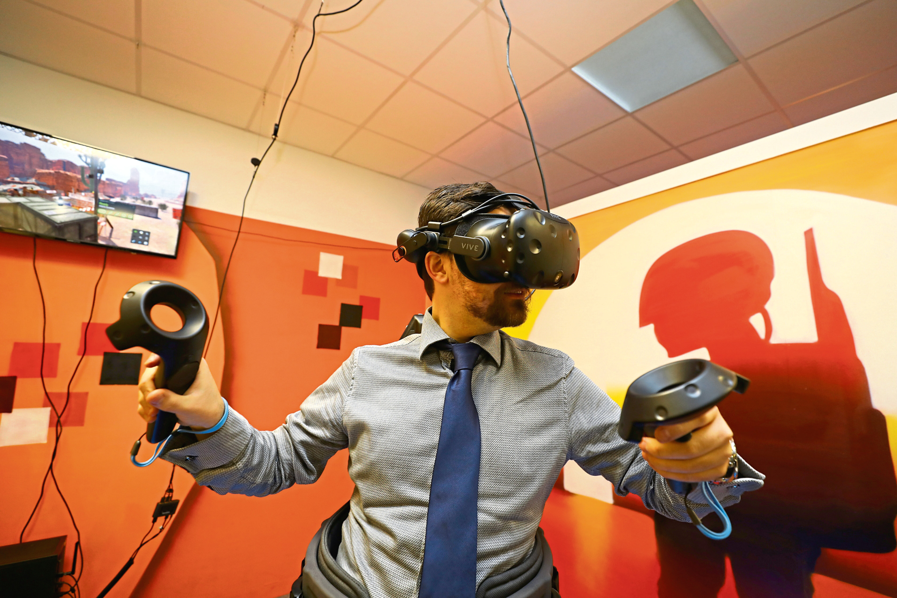 Tele reporter Jon Brady tries out some of the virtual reality equipment.