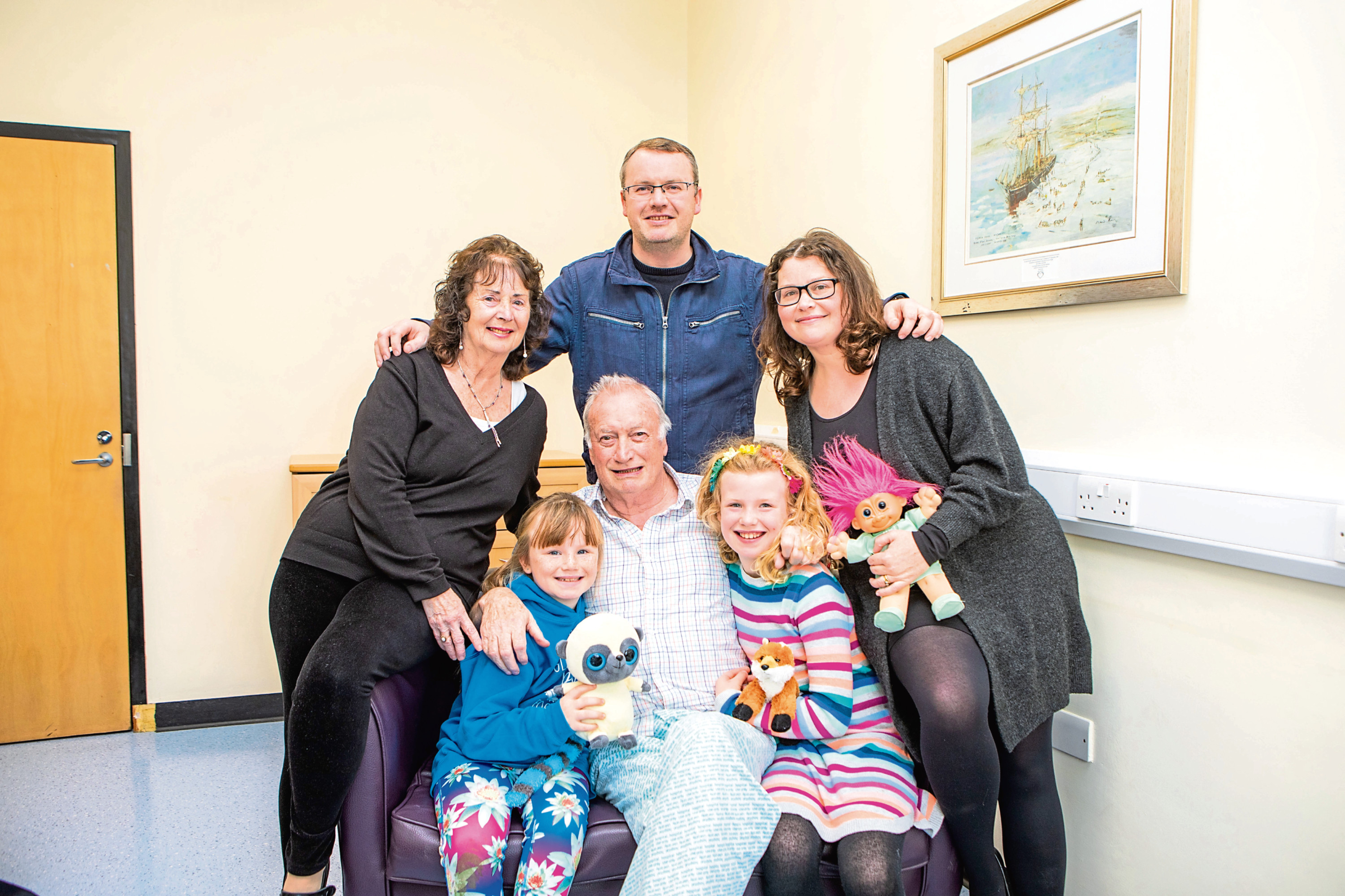 Brian McSweeney, pictured with his family after his heart scare last year.