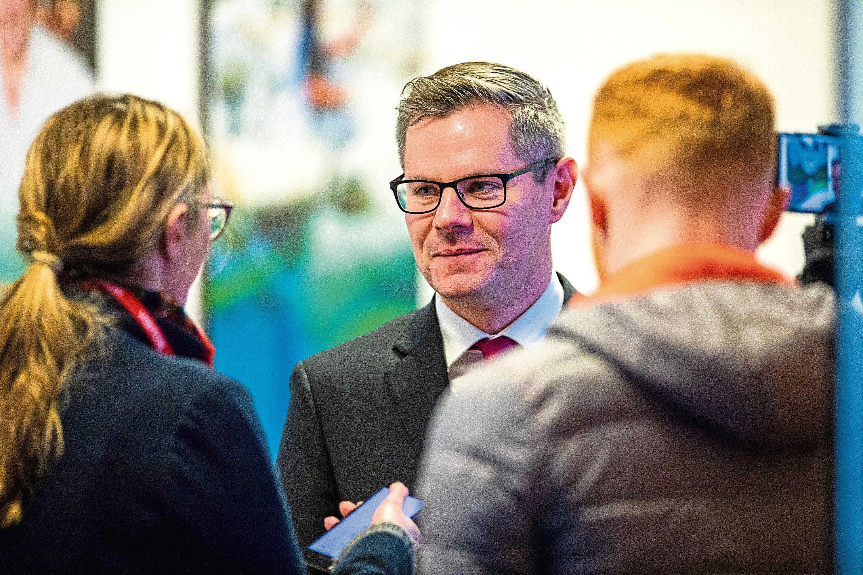 Derek MacKay being interviewed after a meeting on the future of Michelin