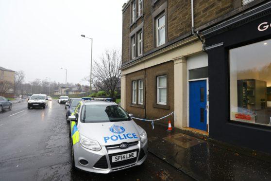 Police on Logie Street where the toddler fell.