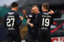 Kenny Miller is congratulated after his debut Dundee goal