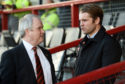Dundee United manager Robbie Neilson speaks with chairman Mike Martin.