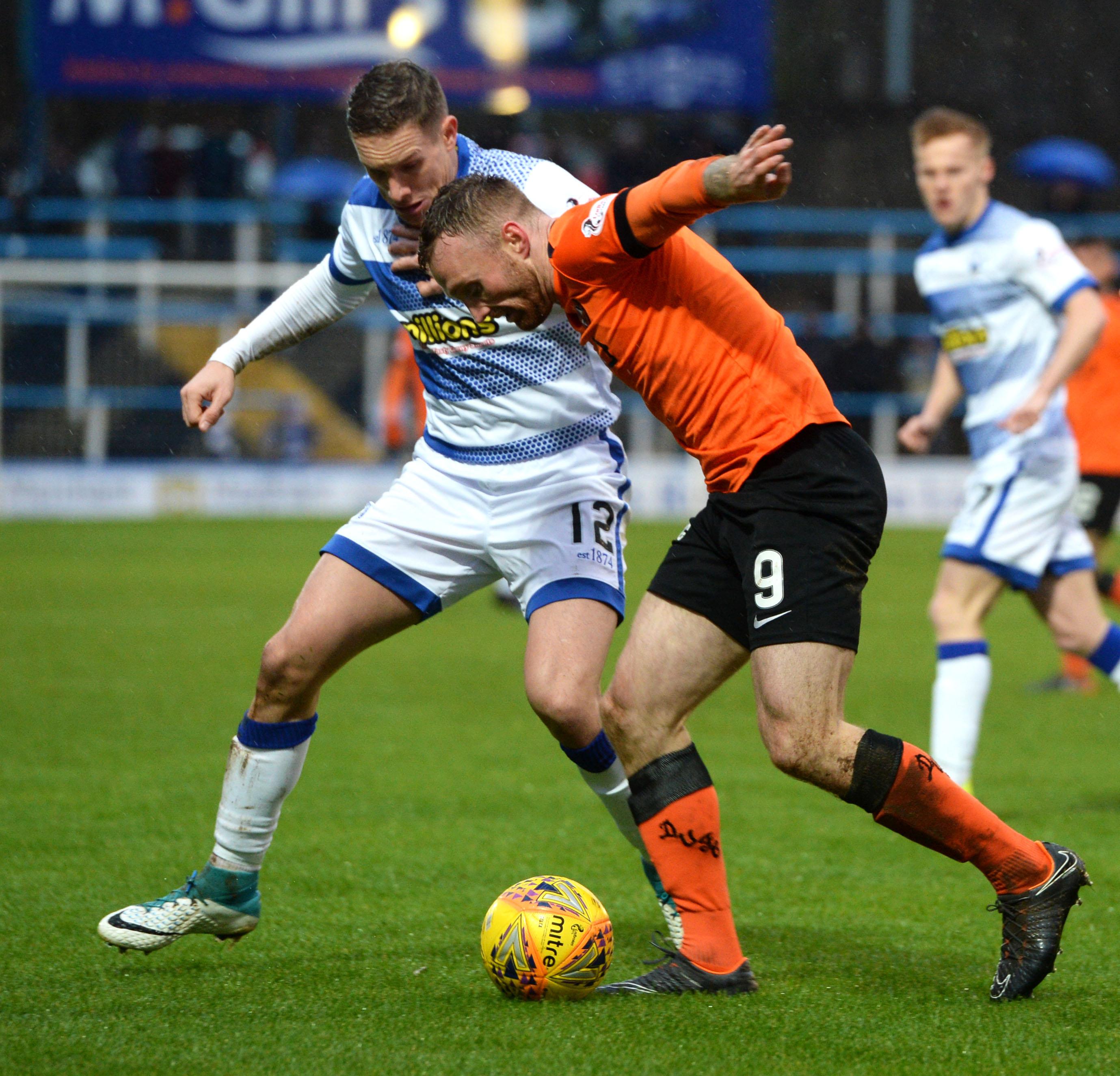 Morton's Michael Tisder battles with Dundee United's Craig Curran.