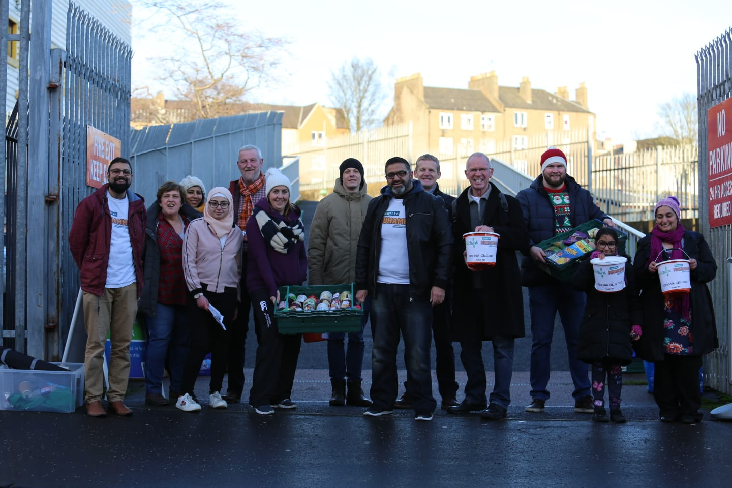Representatives of Taught by Muhammad and the Dundee Foodbank outside Tannadice.