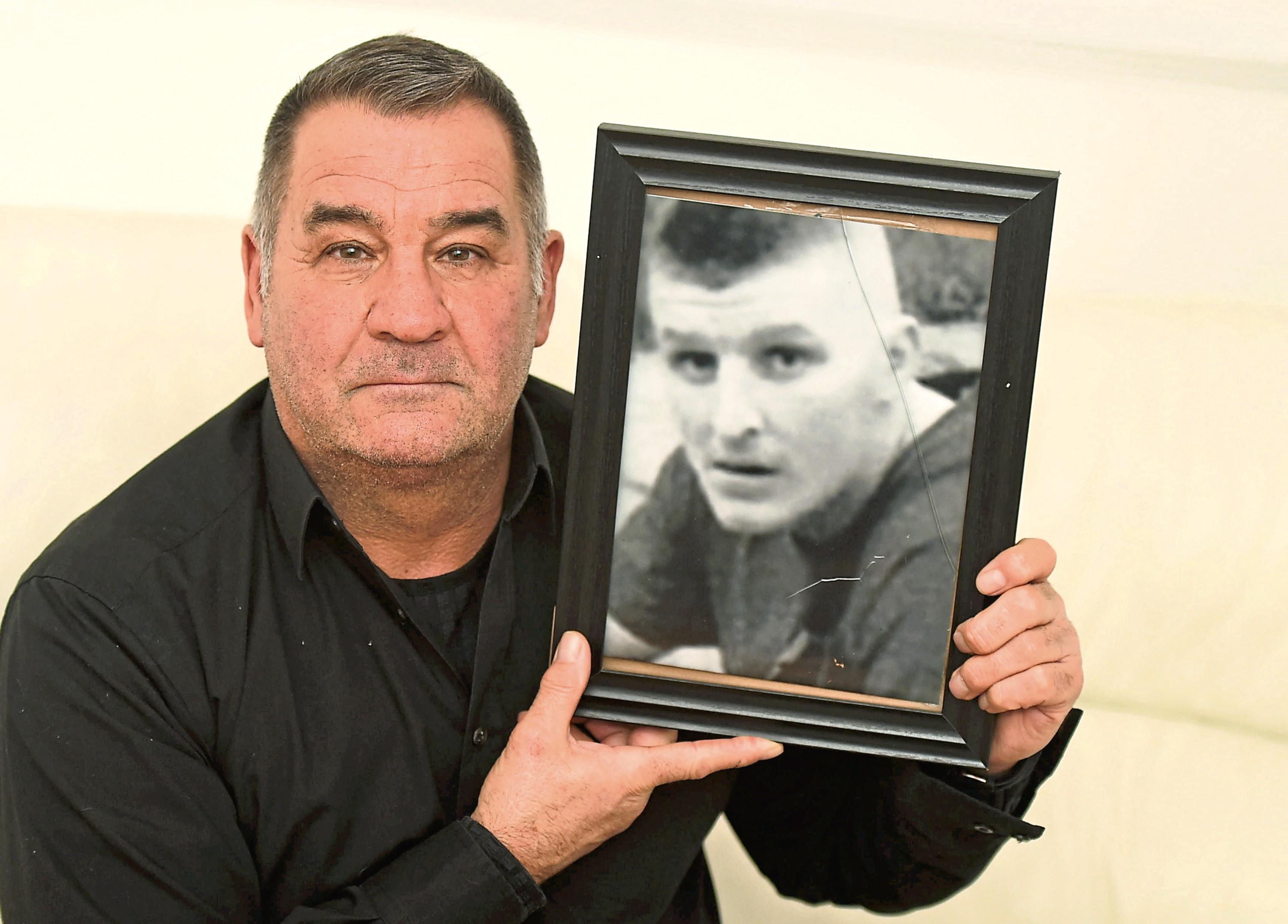 Neil McLennan with a photo of Jamie