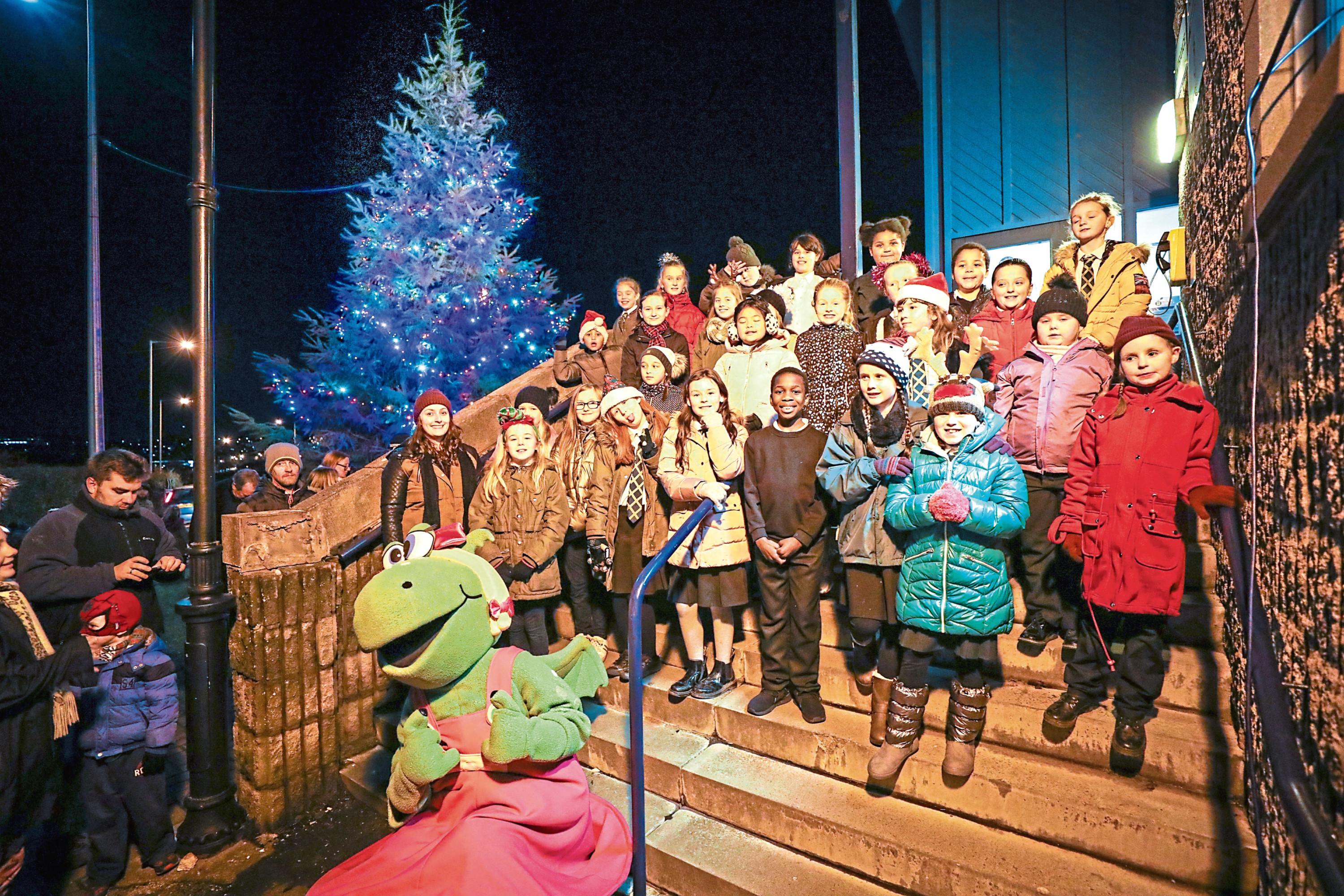 Pupils from St Francis Primary School choir sang at the Longhaugh Christmas lights switch-on