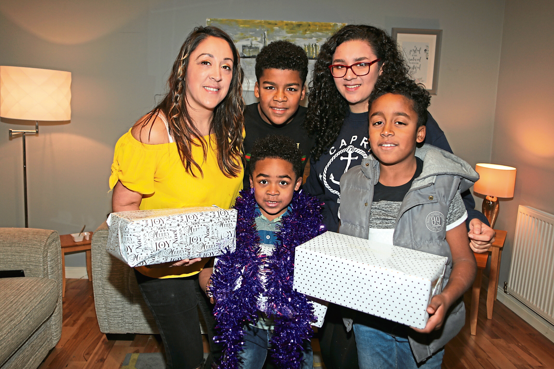 Donna Sangmor with children Noah (9), Jay (11), Daniel (5) and Anisha (14)