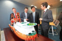 The group's new offices were opened on Thursday in a ceremony attended by COES International president Hong Chong, Business, Fair Work and Skills Minister Jamie Hepburn and Dundee City Council leader John Alexander