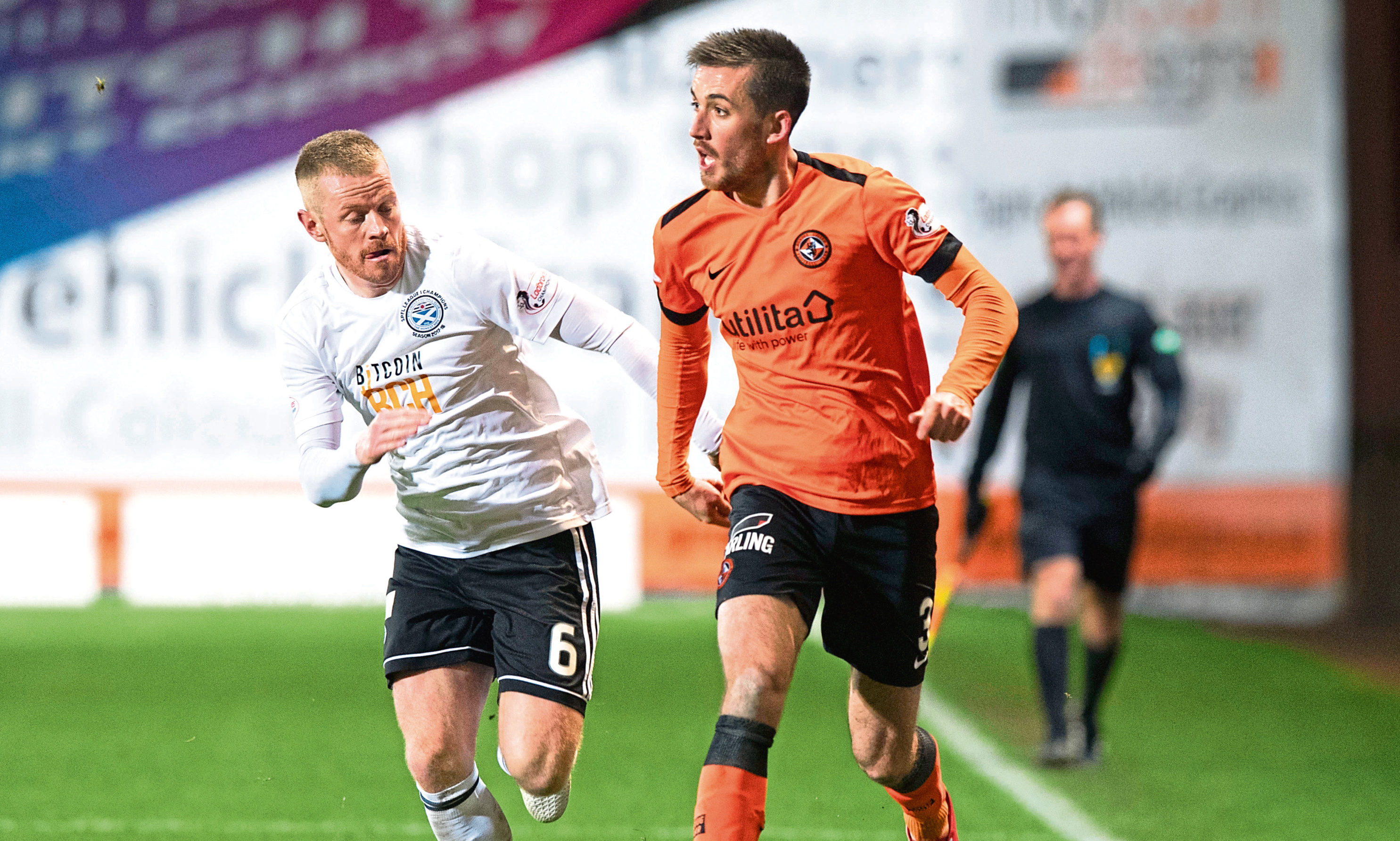 Dundee United left-back Callum Booth in action against Ayr