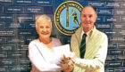 Alex is pictured presenting the cheque to club treasurer Moira Gorrie