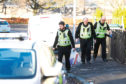 Police leave an address in Pitarlie Road, Dundee