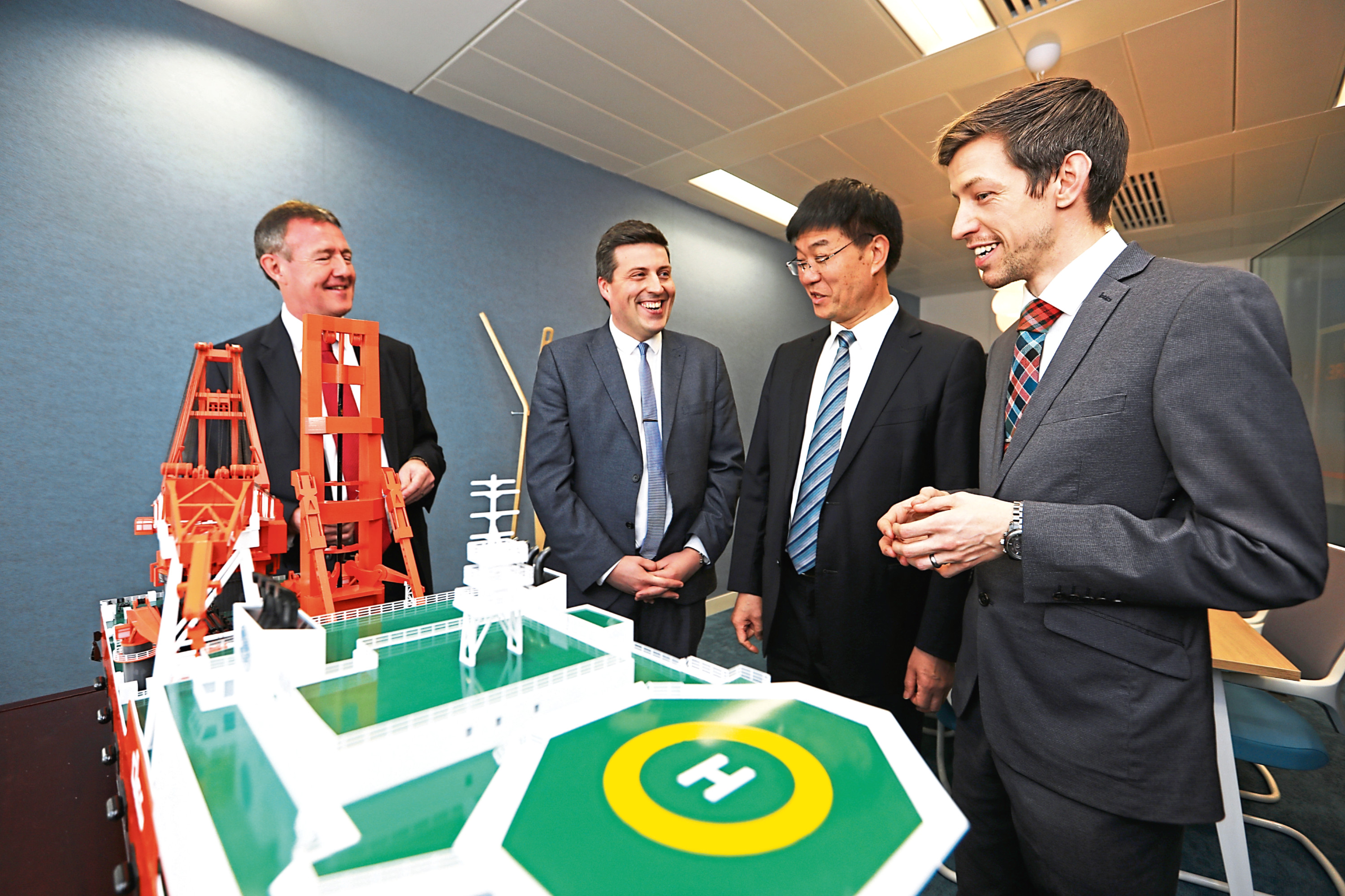 Dundee City Council leader John Alexander, right, with, from left, COES Caledonia director general, professor Norman McLennan, MSP Jamie Hepburn and COES president Hong Chong