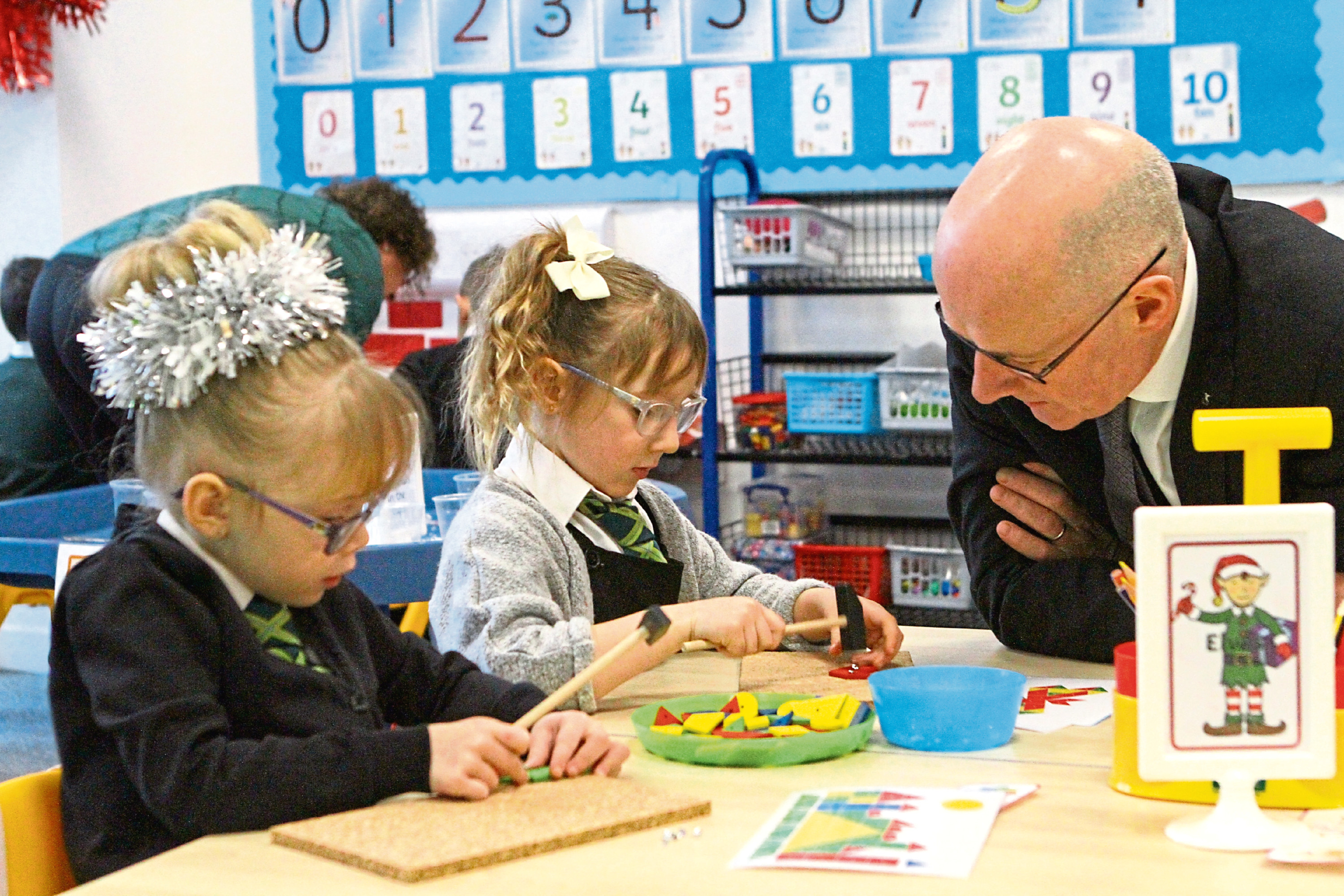 John Swinney with Laya Sime (left) and Bella Petrie, both in P1 at St Francis Primary