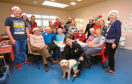 Picture shows Ukelele group Dee Ukes, back, and Carla Mounsey and her dog Quill, front, and customers and friends at the Dementia Cafe Christmas party