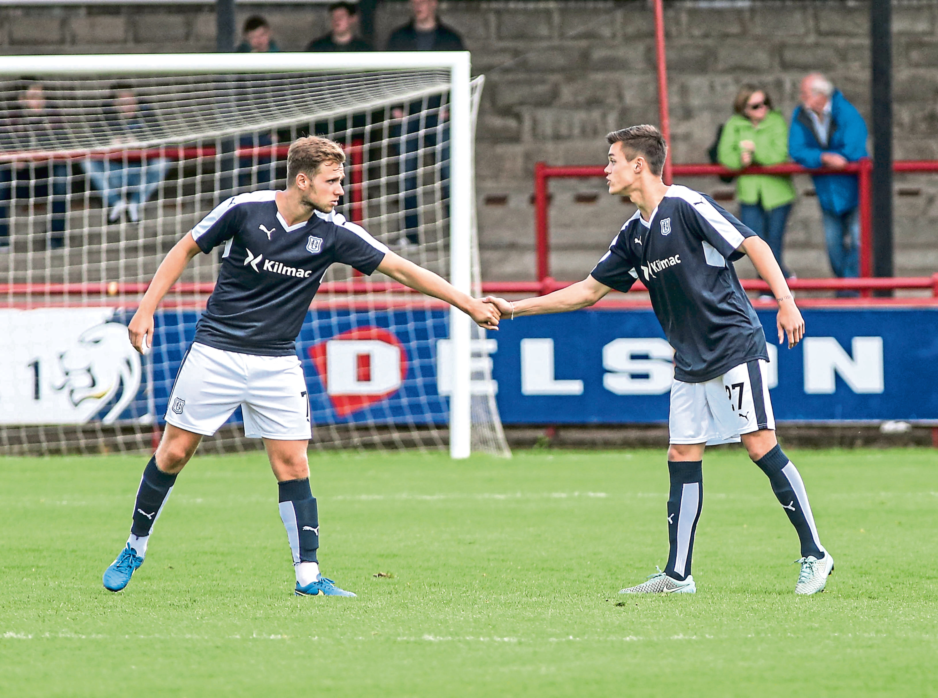 Jesse Curran (right) is welcomed on to the pitch by now Kilmarnock man Greg Stewart as the Aussie kid made his Dundee debut in a pre-season friendly at Brechin back in 2015