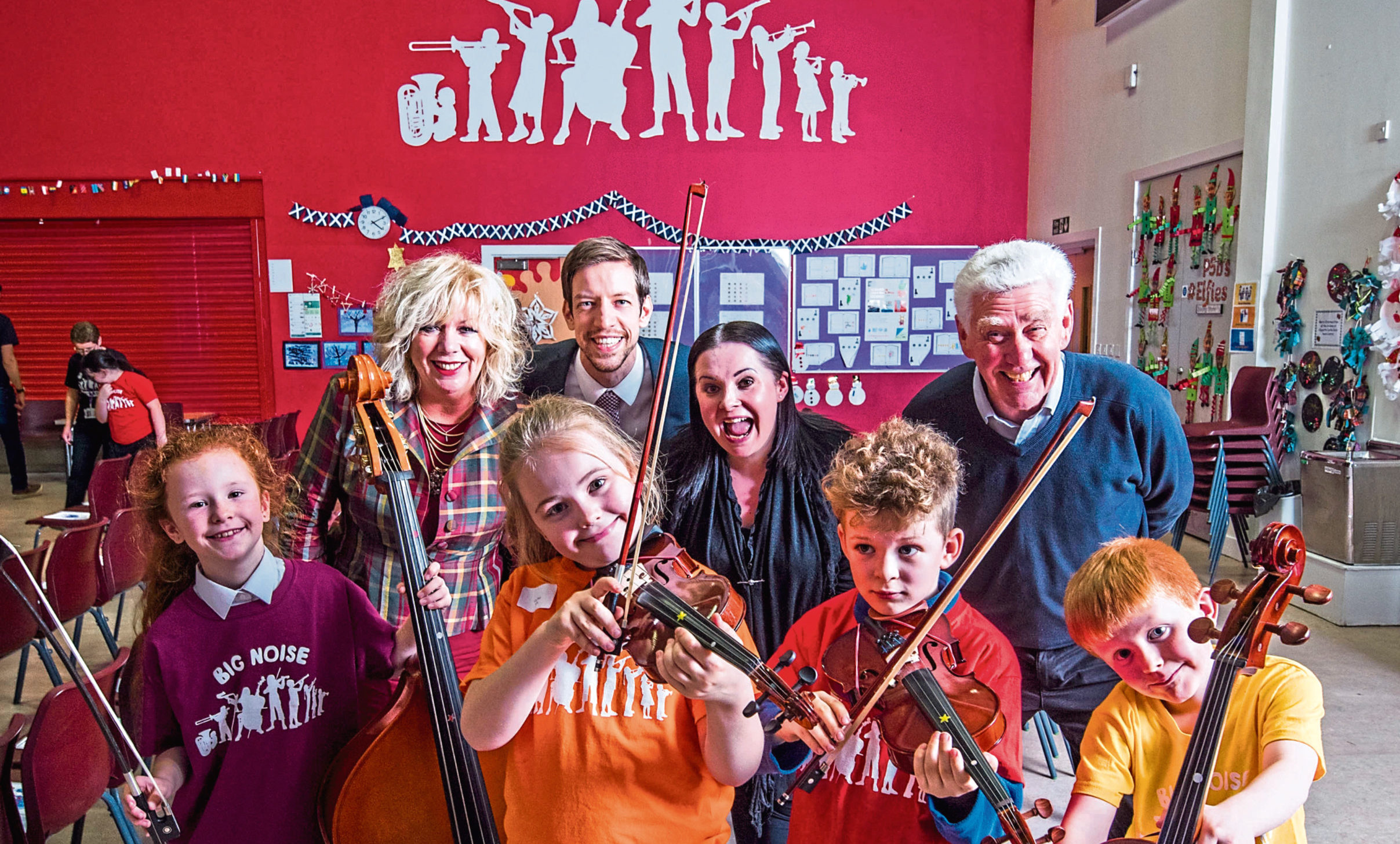 Picture shows (from left) Billy McLean, Councillor Audrey May, Cara Stott, council leader John Alexander, Alice Marra from Optimistic Sound, Olly Muckersie, Michael Craig from Optimistic Sound and Robert Ralf