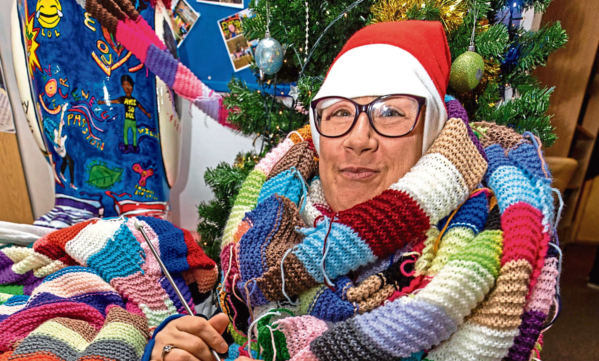 Tina Poynter is hoping to break the world record for longest knitted scarf