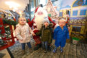 Santa with, from left, Payton Donnett, Karsyn Stewart and John MacQueen, all age 2, at the Magic Of Christmas event in the Overgate Centre in Dundee