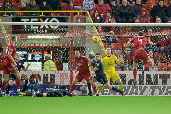 Aberdeen's Andy Considine (No 4) is free and clear to power a header in to make it 3-0 on Tuesday night with Andy Boyle and Nathan Ralph on the floor
