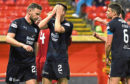 Darren O'Dea (right) along with Cammy Kerr (No 2) and Andy Boyle look                            on with dismay as Aberdeen celebrate their fifth goal in a 5-1 hammering at Pittodrie on Tuesday night