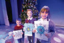 The winners with their snowflakes, left to right, Alexander Guthrie, 4, from Isla Primary School; Logan Ballingall, 7, and Holly Millar, 8, from Blackness Primary School