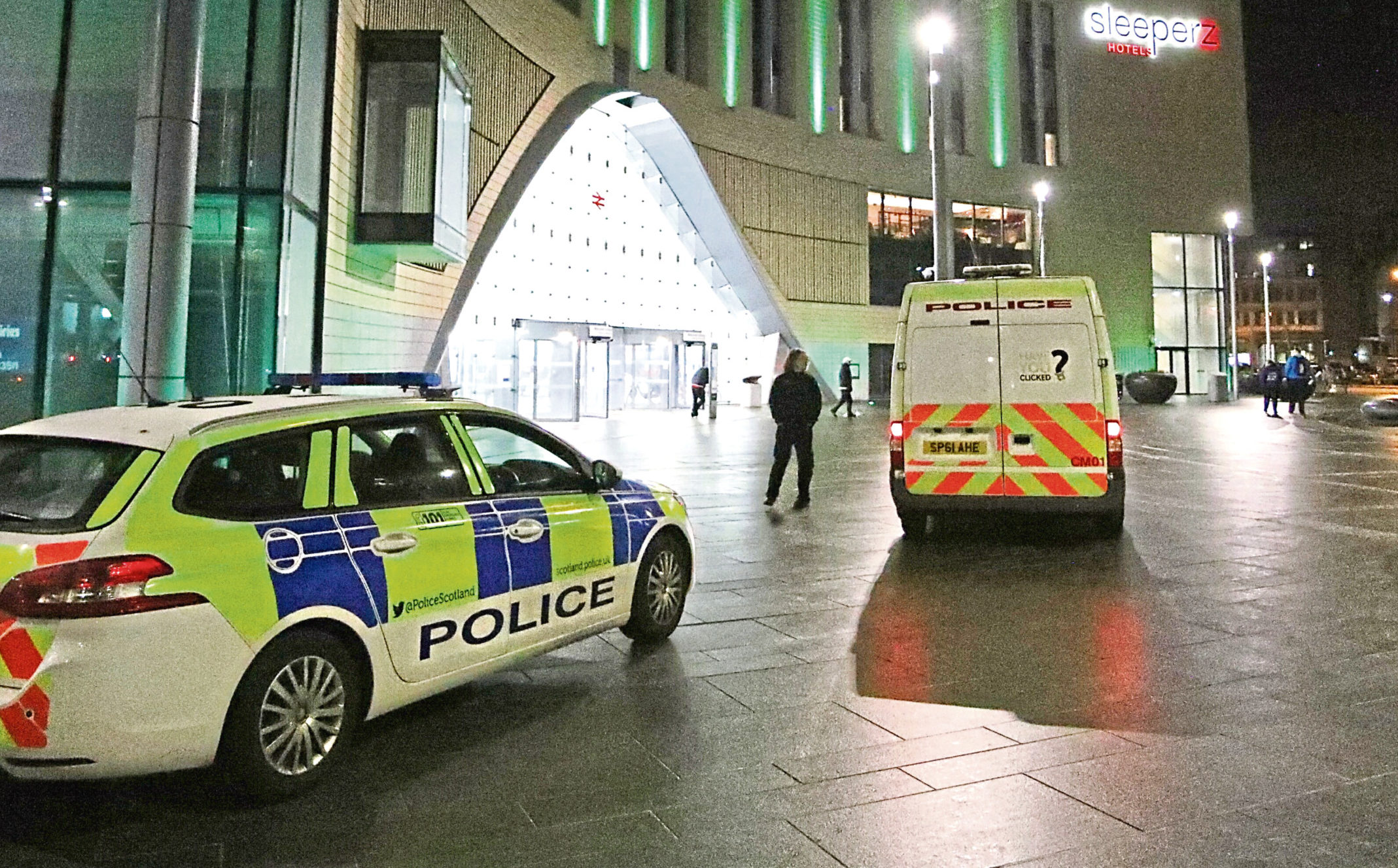 Police outside Dundee Railway Station after the incident.