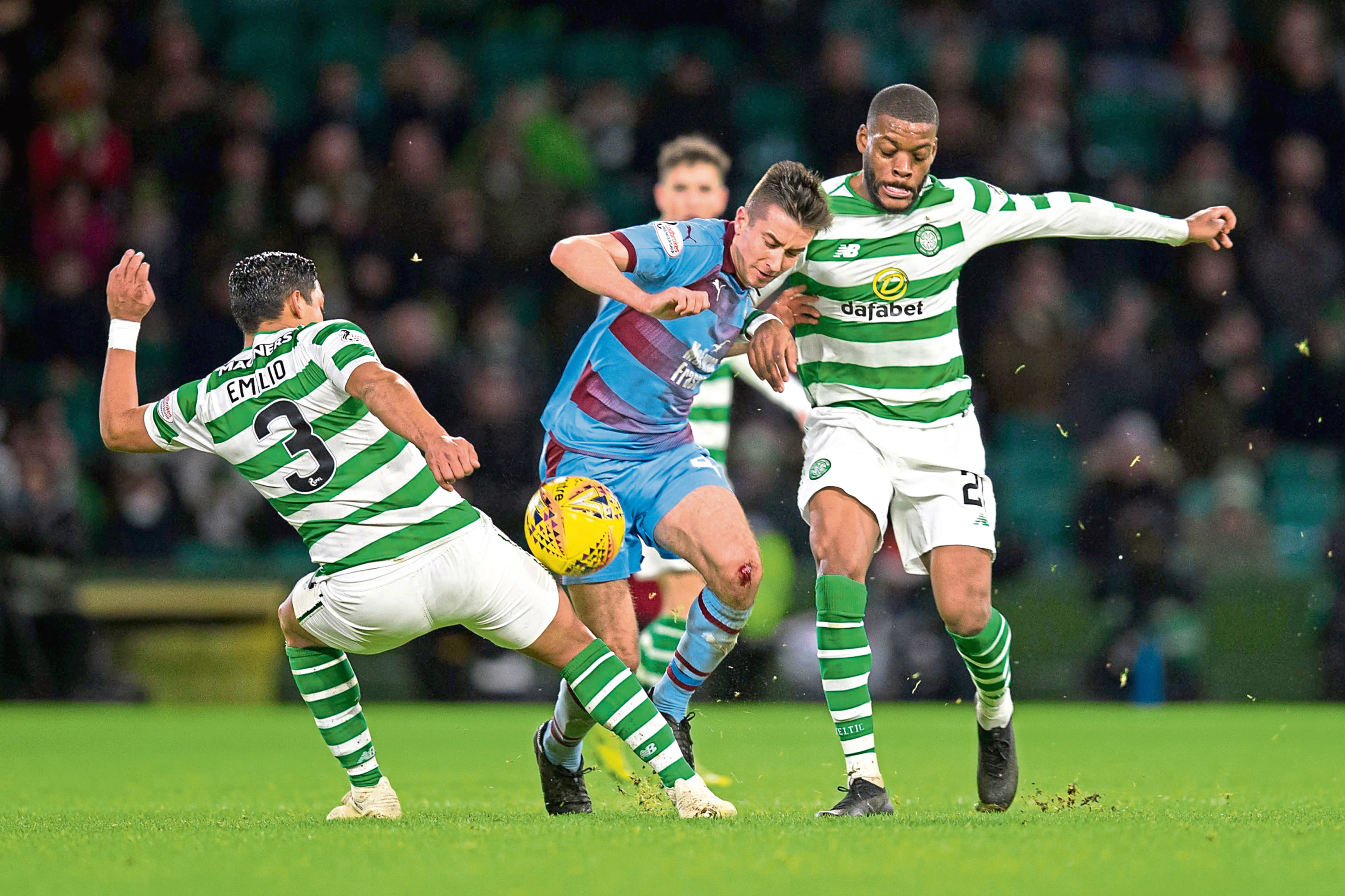 Cammy Kerr of Dundee challenges for the ball with Emilio Izaguirre and Olivier Ntcham of Celtic.