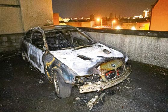 The remains of the BMW destroyed in the fire.