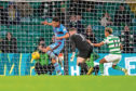 Nathan Ralph clears off the goal-line against Celtic.